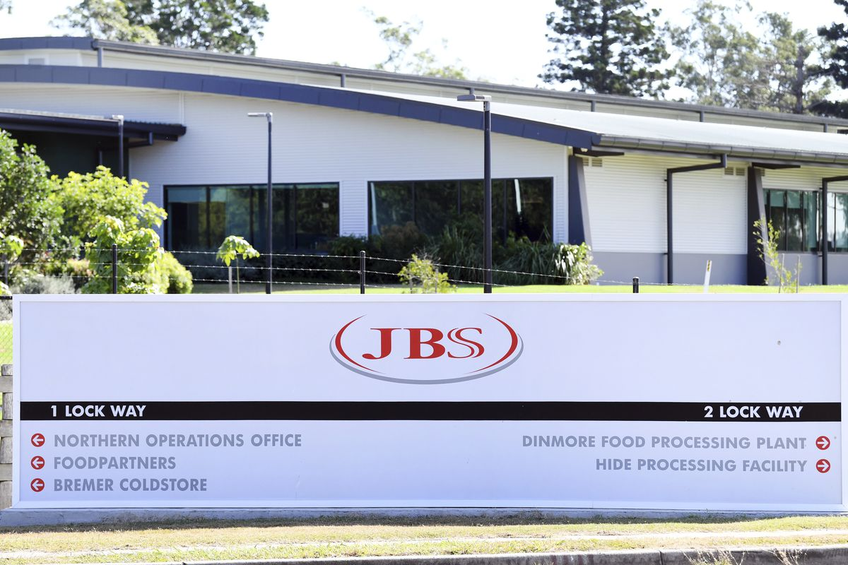 The company logo sign sits at the entrance to the JBS Australia's Dinmore meatworks facility.