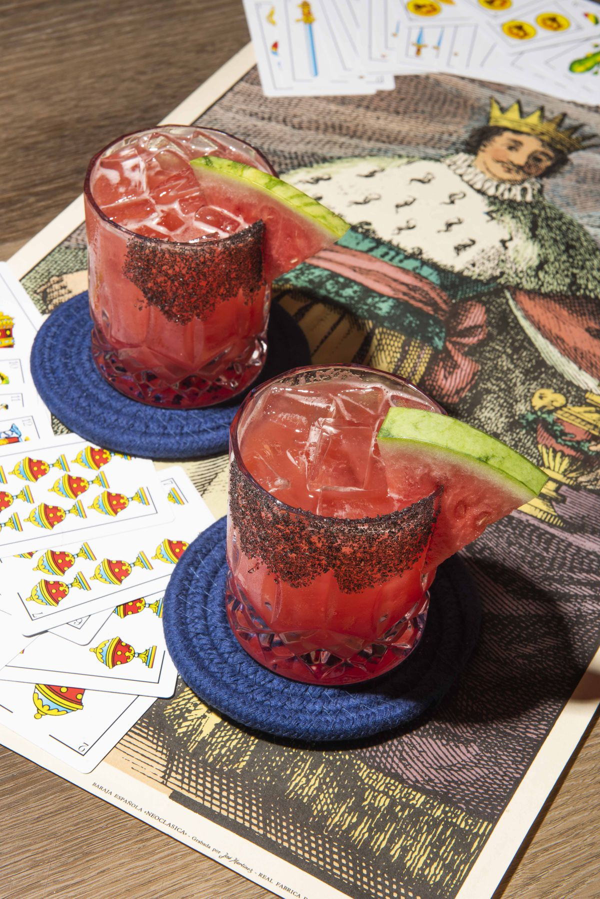 Two pink cocktails garnished with watermelon