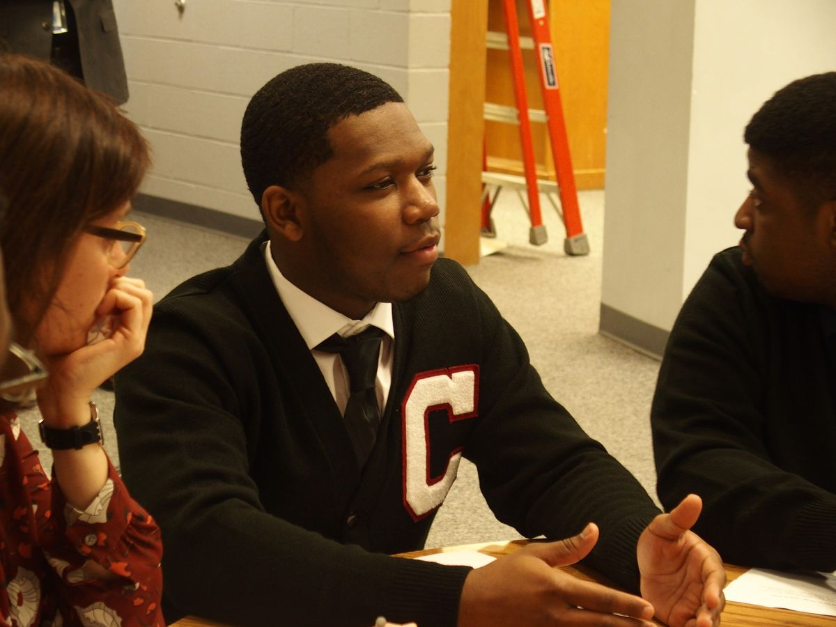 Cameron Al-Wali, a senior at G.W. Carver College and Career Academy leads a discussion on student recommendations to reduce suspensions and expulsions.