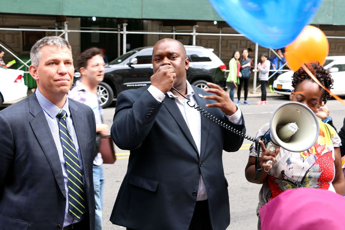 Deputy Mayor Richard Buery and Christopher Caruso, who heads the education department's community schools office.
