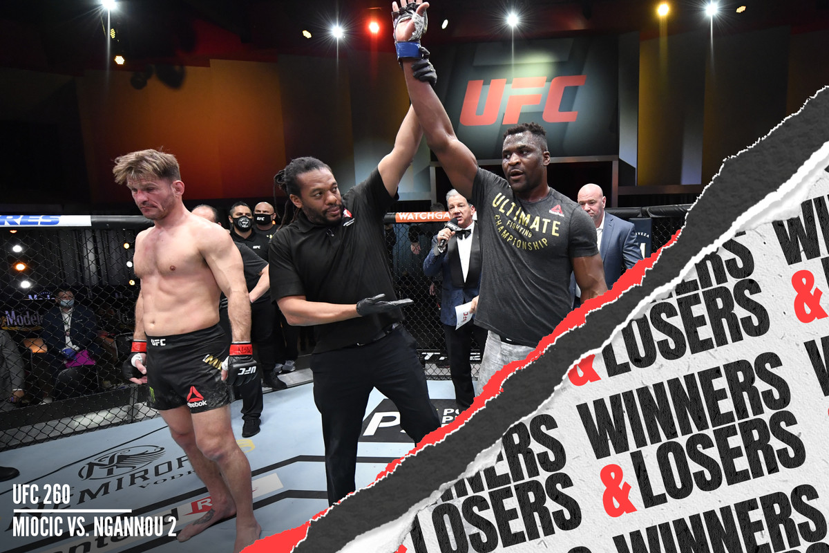 Francis Ngannou gets his hand raised after knocking out Stipe Miocic to become the new UFC heavyweight champion.