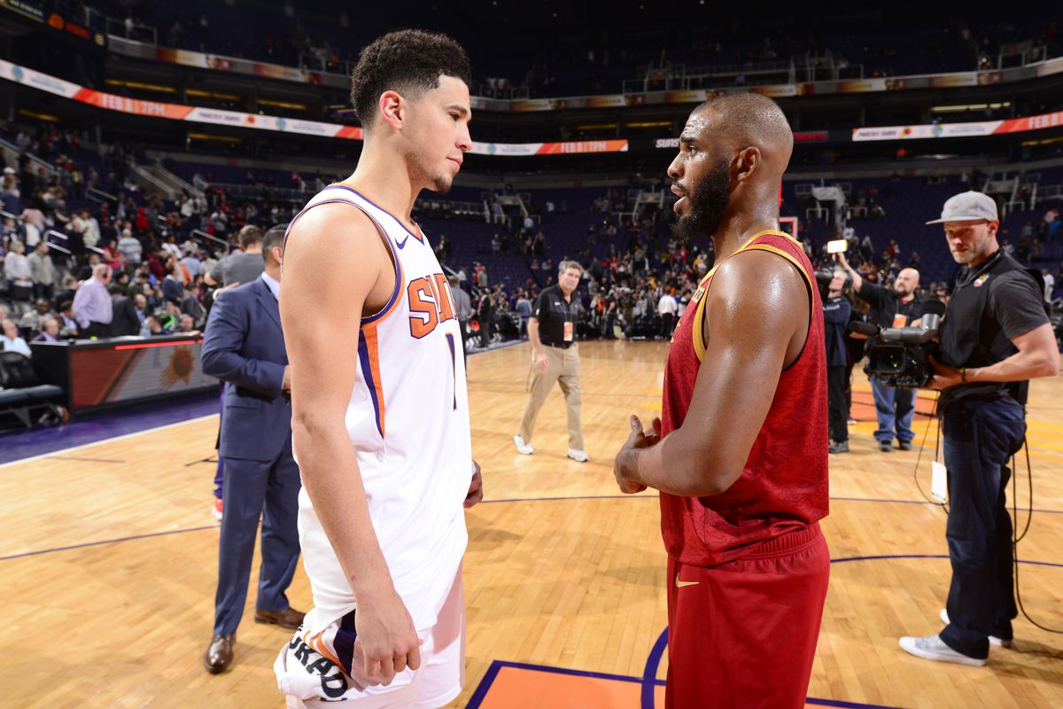 Devin Booker of the Phoenix Suns and Chris Paul of the Houston Rockets talk after the game on February 4. 2019 at Talking Stick Resort Arena in Phoenix, Arizona.