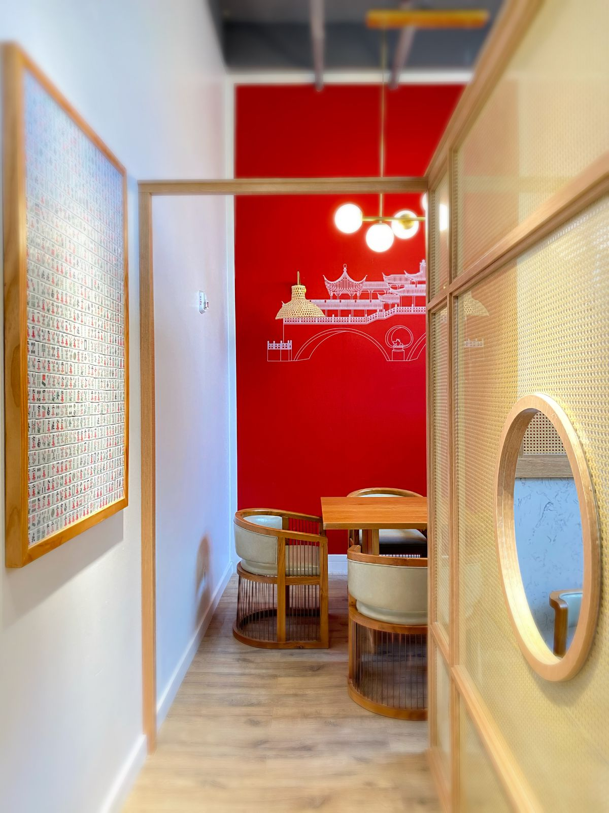 A small hallway at Chengdu Taste, with a view of an alcove table
