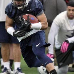 Iona Pritchard runs with the ball during BYU spring football practice at BYU in Provo on Friday, March 22, 2013.