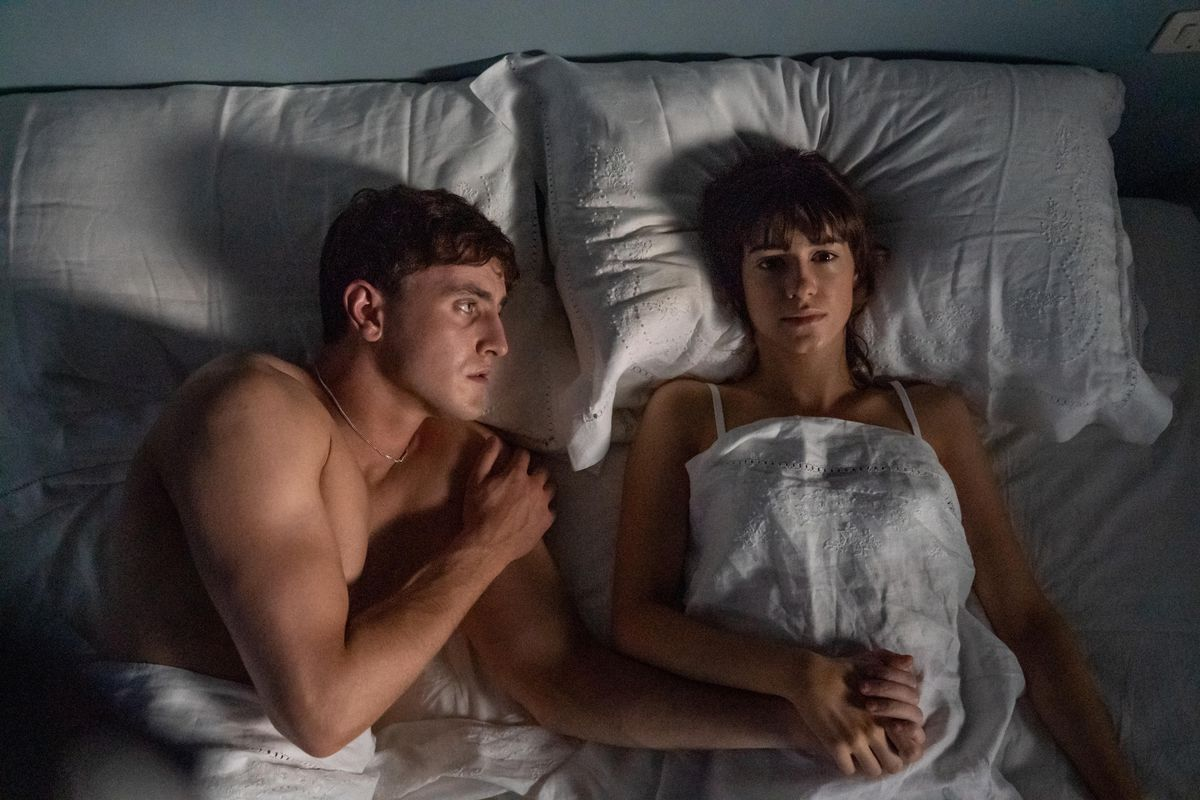 Connell and Marianne lie next to each other in bed on the show Normal People.
