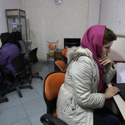 """In this Monday, Feb. 13, 2012 file photo, Iranian women use computers at an Internet cafe in central Tehran. Iran""""™s cyber monitors often tout their efforts to fight the West""""™s 'soft war' of influence through the web, but trying to ban Google""""™s popular Gmail may have gone too far with complaints coming even from email-starved parliament members."""