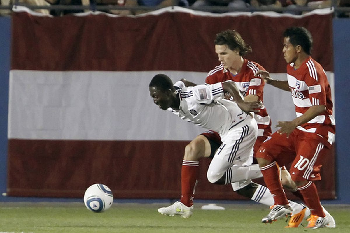 FRISCO, TX - MARCH 19: Patrick Nyarko #14 of the Chicago Fire tries to get past Zach Loyd #19 and David Ferreira #10 of FC Dallas during the second half at Pizza Hut Park on March 19, 2011 in Frisco, Texas. (Photo by Brandon Wade/Getty Images)