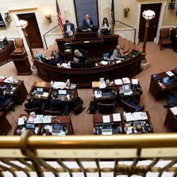 Senate President Stuart Adams, R-Layton, senators and staff work in the Senate chamber on the final day of the legislative session at the Capitol in Salt Lake City on Thursday, March 12, 2020.