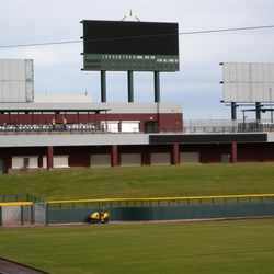 Wide view of left-field berm and scoreboard. The two boards on either side of the main board will have fixed ads