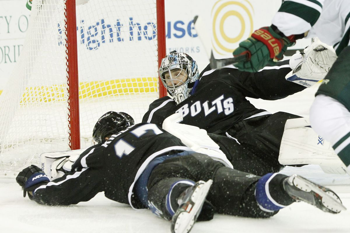 Tampa Bay's Alex Kilorn and Ben Bishop, both without their sticks, fend off a Minnesota power play in the Lightning's 2-1 win Saturday night.