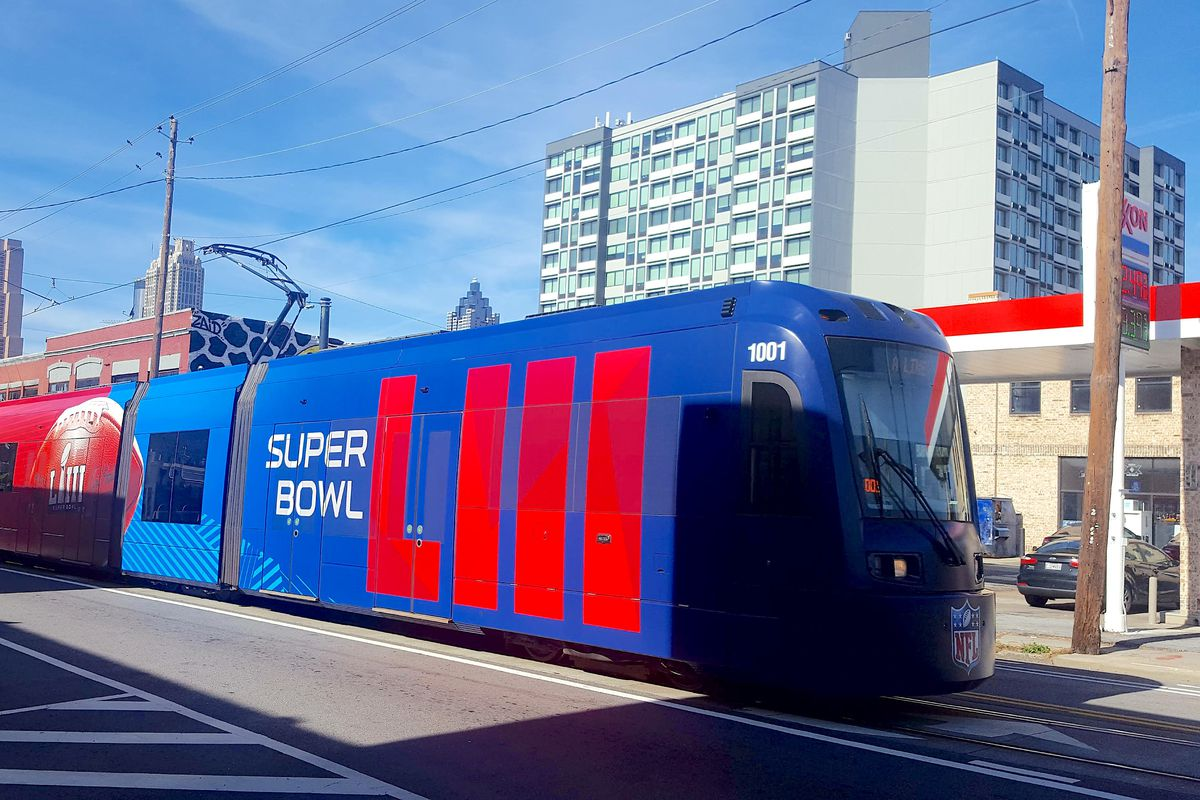 a photo of the streetcar wrapped in Super Bowl garb