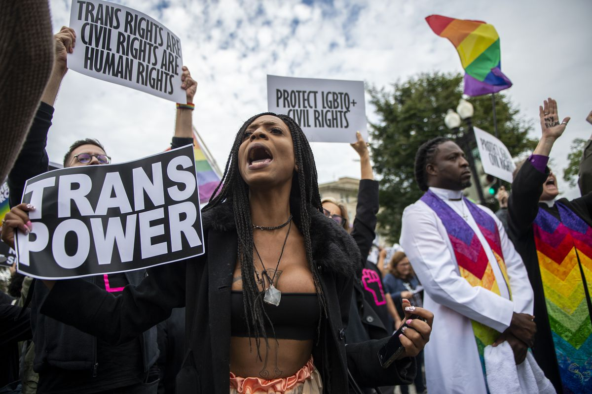 Protesters block the street in front of the Supreme Court as it hears arguments on whether gay and transgender people are covered by a federal law barring employment discrimination on the basis of sex on Tuesday, Oct. 8, 2019.