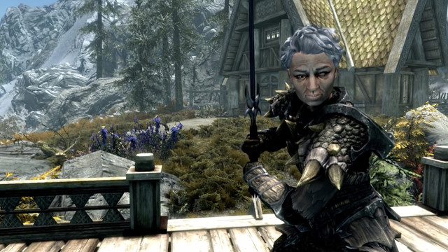 A shot of a character from Skyrim. She has grey hair and dragon armor.
