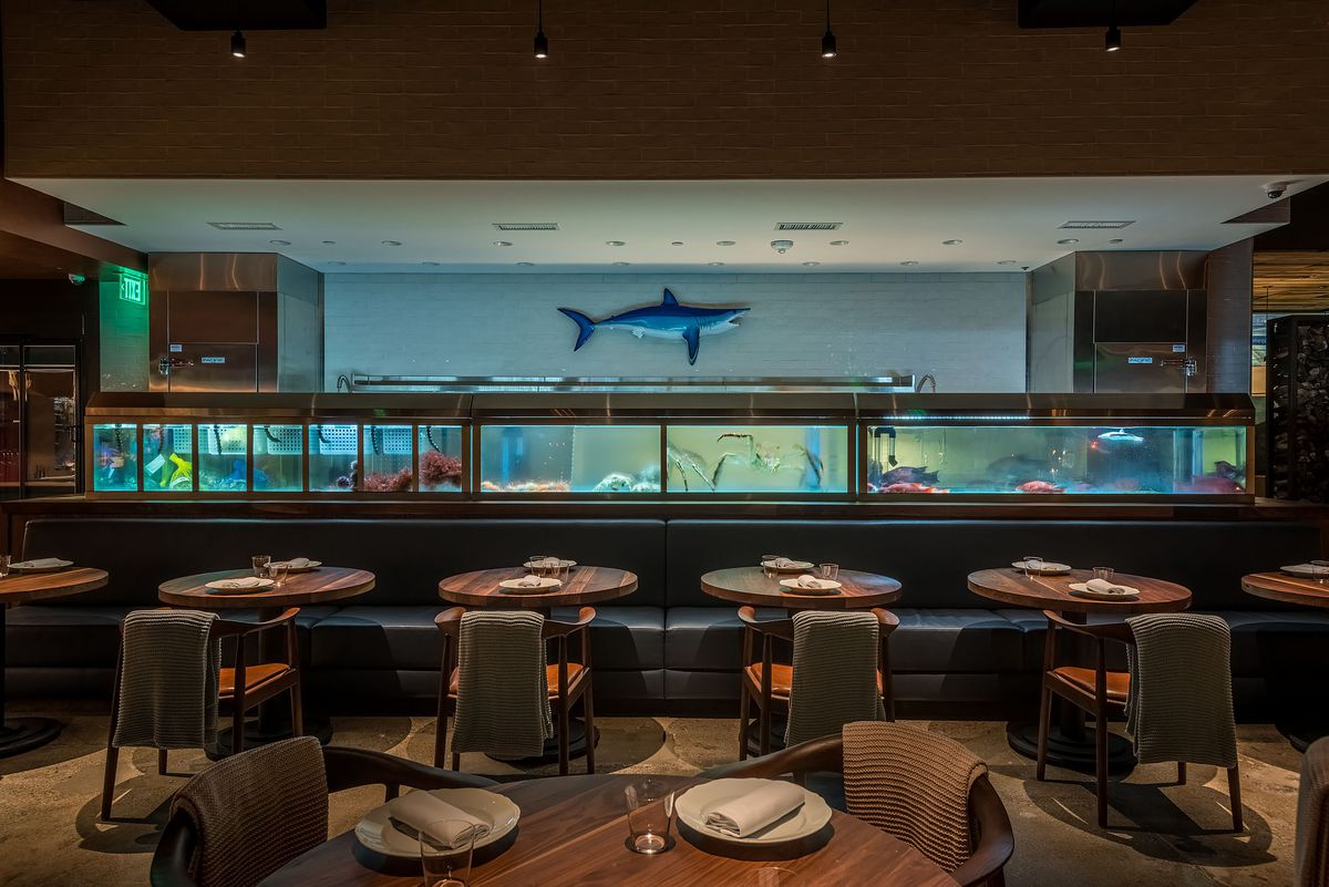 Fish tanks and tables at Angler in Los Angeles.