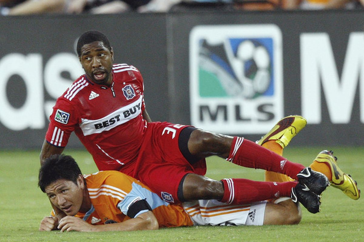 No pictures of Robinson in TFC red available, but enjoy this picture of him using Brian Ching as a couch.