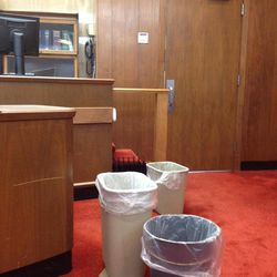 An array of wastebaskets catching drips from a roof leak above the courtroom of Muskegon County 14th Circuit Judge Timothy G. Hicks on Wednesday, Sept. 5, 2012 in Muskegon. Off and on for more than a month, the ceiling of the courtroom has been leaking big, fairly rapid drops of brown water.  (AP Photo-John S. Hausman/The Muskegon Chronicle).