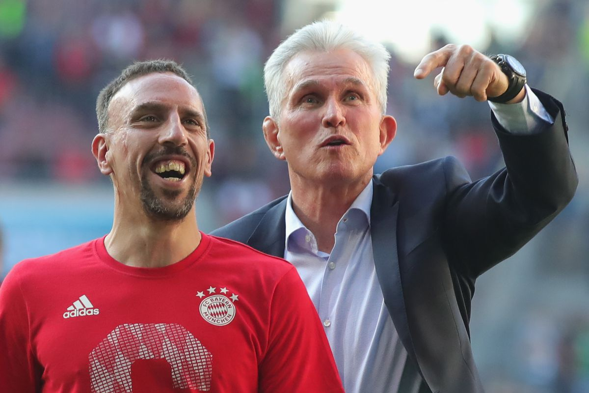 AUGSBURG, GERMANY - APRIL 07: Jupp Heynckes, head coach of Bayern Muechen (r) celebrates in front of their supporters with Franck Ribery of Bayern Muenchen winning the 6th championship back to back, after the Bundesliga match between FC Augsburg and FC Bayern Muenchen at WWK-Arena on April 7, 2018 in Augsburg, Germany.