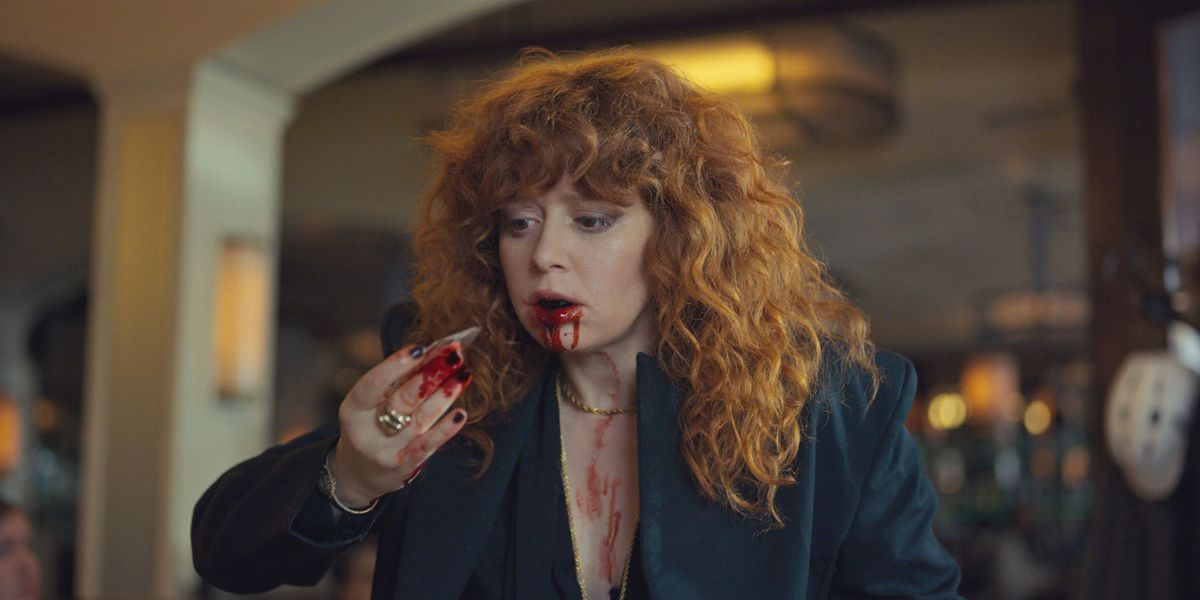 russian doll - red-haired woman spits blood
