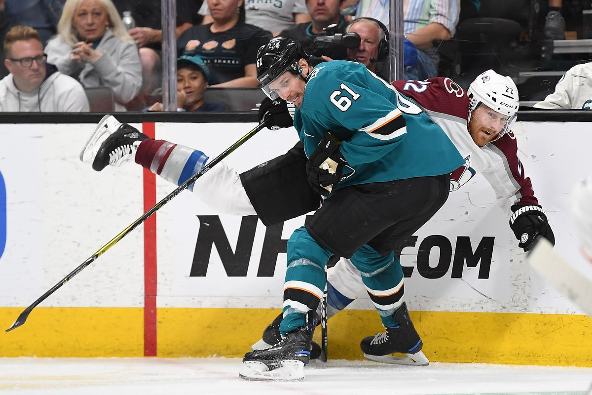 Colin Wilson of the Colorado Avalanche gets checked up against the boards by Justin Braun of the San Jose Sharks during the third period in Game 5 of the Western Conference Second Round during the 2019 NHL Stanley Cup Playoffs at SAP Center on May 4, 2019