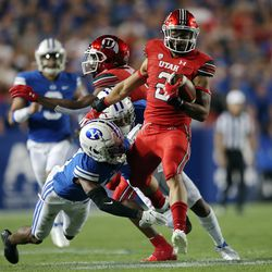 Brigham Young Cougars defensive back Isaiah Herron (11) brings down Utah Utes running back Micah Bernard (2) as BYU and Utah play an NCAA football game at LaVell Edwards Stadium in Provo on Saturday, Sept. 11, 2021. BYU won 26-17, ending a nine-game losing streak to the Utes.