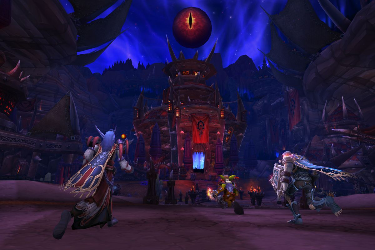 World of Warcraft - players run through a corrupted version of Orgrimmar.