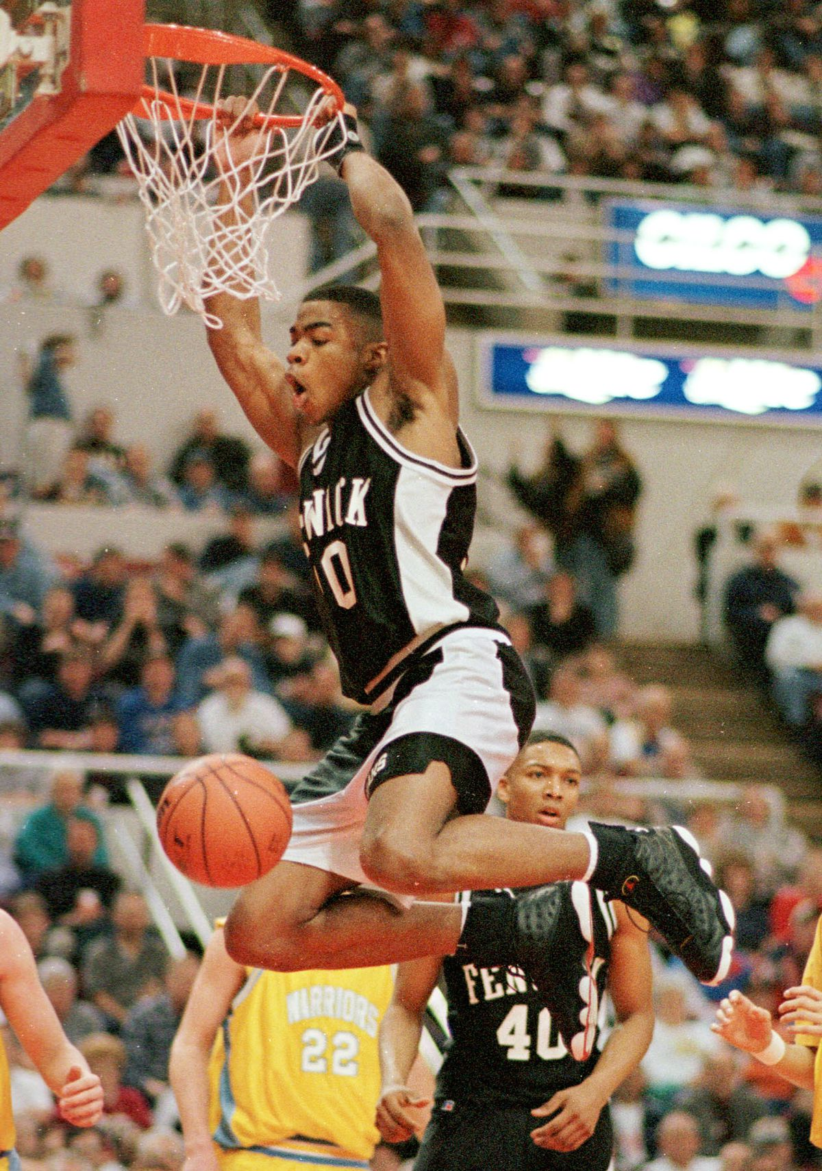 Fenwick's Corey Maggette slam dunks against Maine West in a Class AA Quarterfinal game in Peoria.