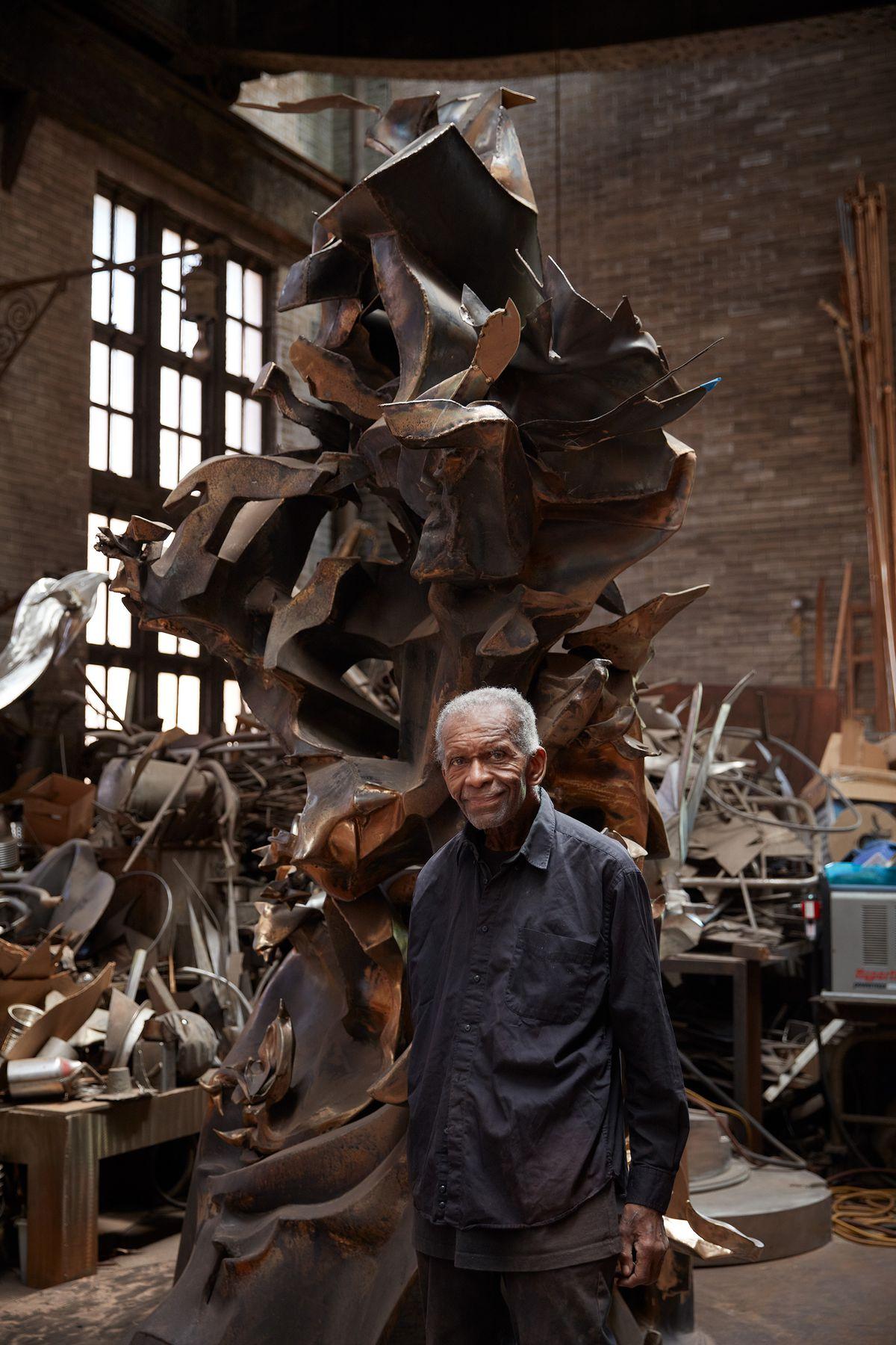 Richard Hunt in his studio with the sculptureScholar's Rock or Stone of Hope or Love of Bronze (2014–2020).
