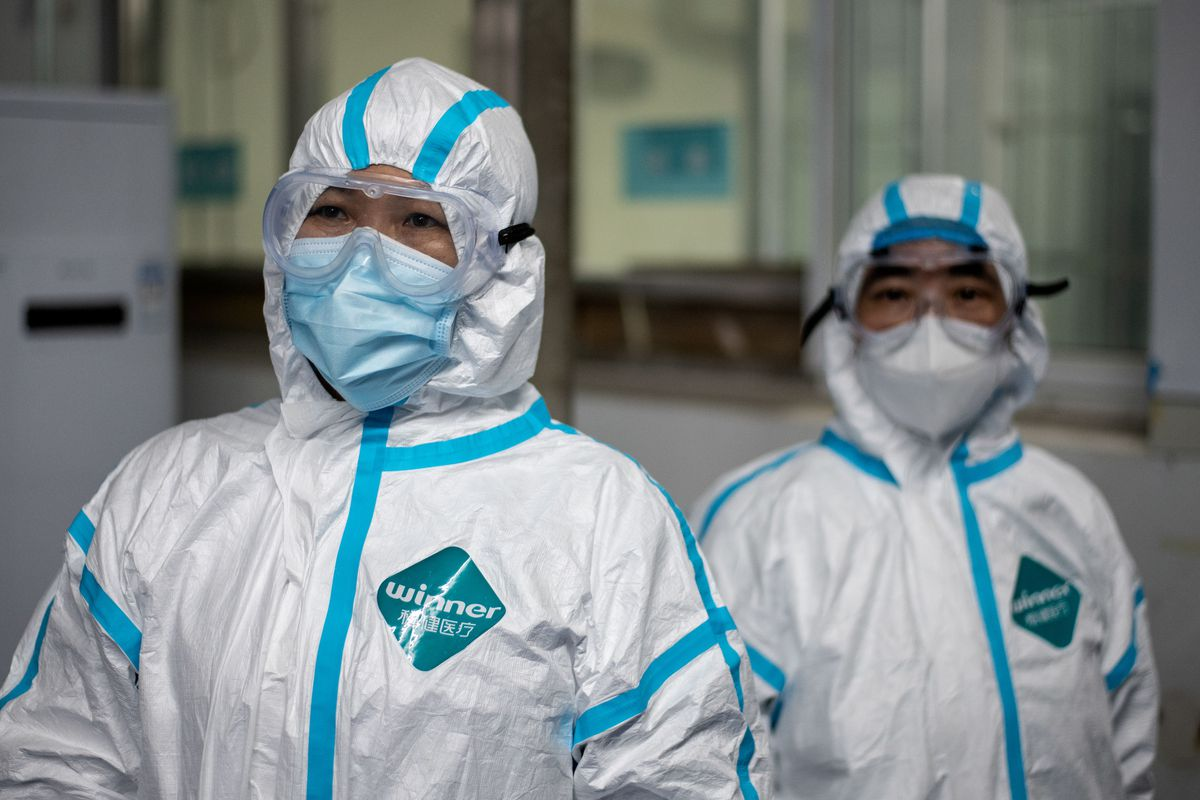 Medical workers wearing hazmat suits as a preventive measure against the coronavirus are seen at a fever clinic in Huanggang Zhongxin Hospital in Huanggang, China.