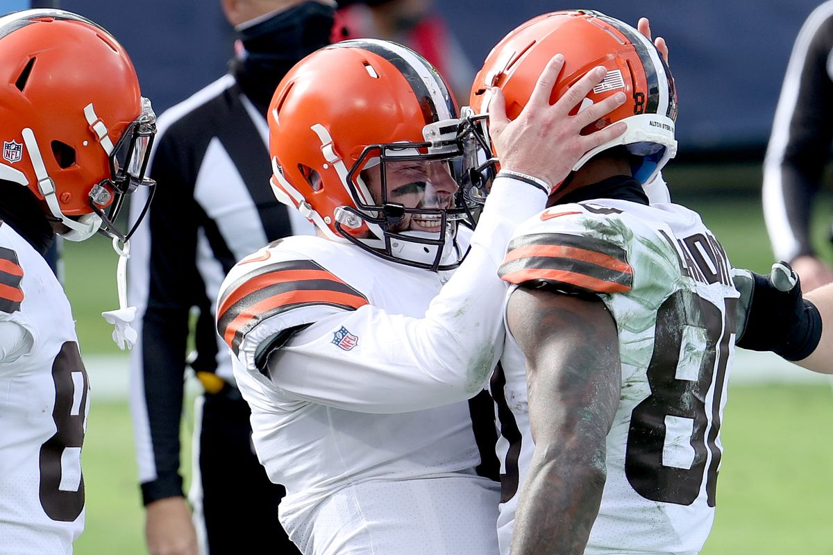 Quarterback Baker Mayfield #6 and Jarvis Landry #80 Cleveland Browns celebrate a touchdown against the Tennessee Titans in the first quarter in the first quarter at Nissan Stadium on December 06, 2020 in Nashville, Tennessee.