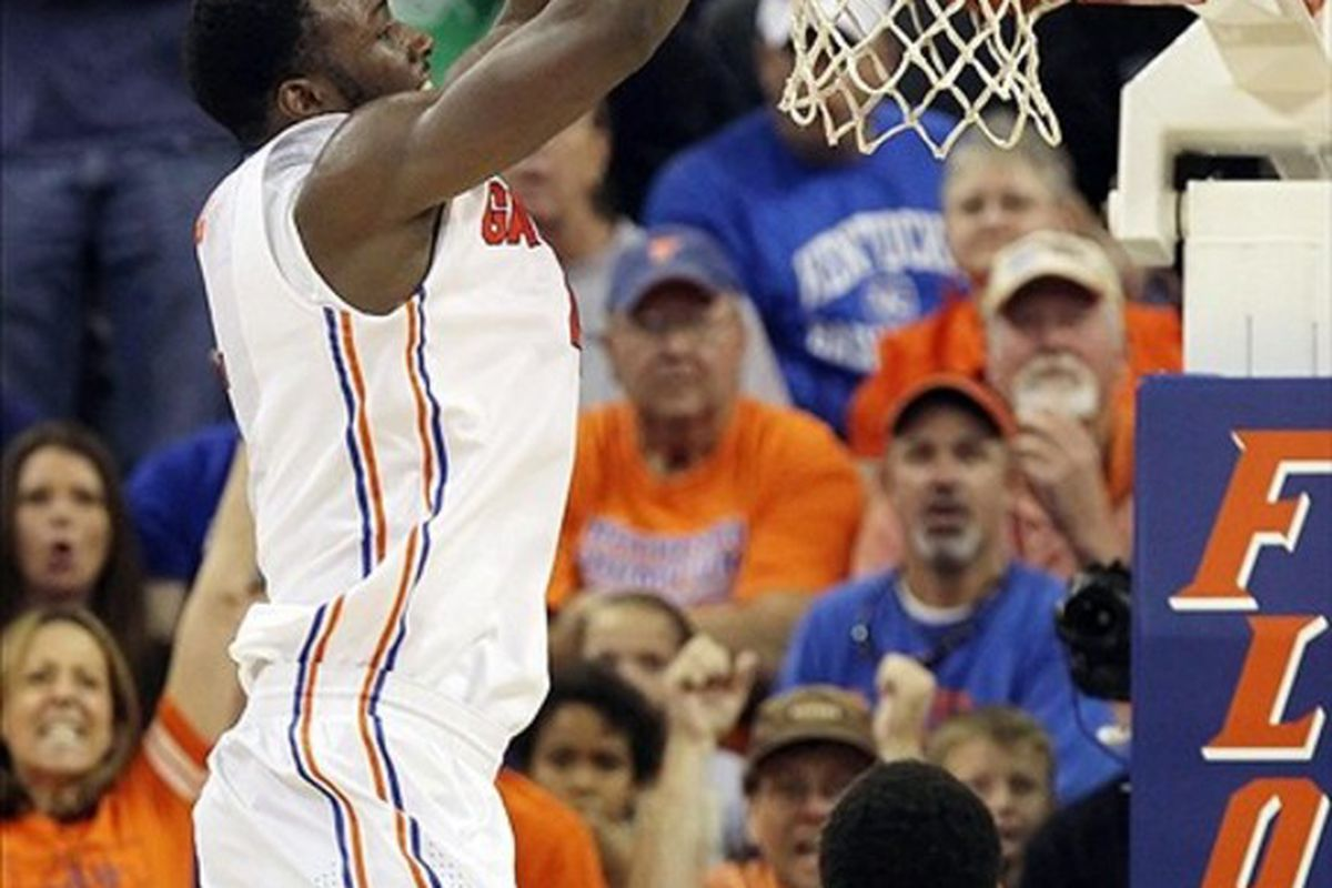 March 4, 2012; Gainesville, FL, USA; Florida Gators forward/center Patric Young (4) dunks during the second half against the Kentucky Wildcats at the Stephen C. O'Connell Center. Kentucky won 74-59. Mandatory Credit: Kim Klement-US PRESSWIRE