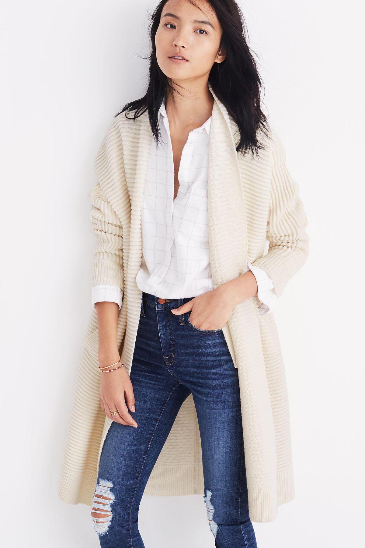 a white sweater coat