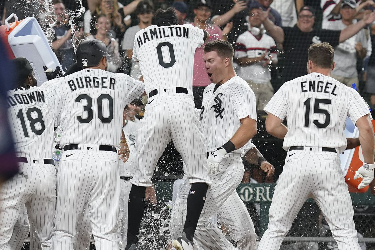 Gavin Sheets of the White Sox is congratulated by teammates after his three-run home run to win the second game of Monday's doubleheader against the Twins.