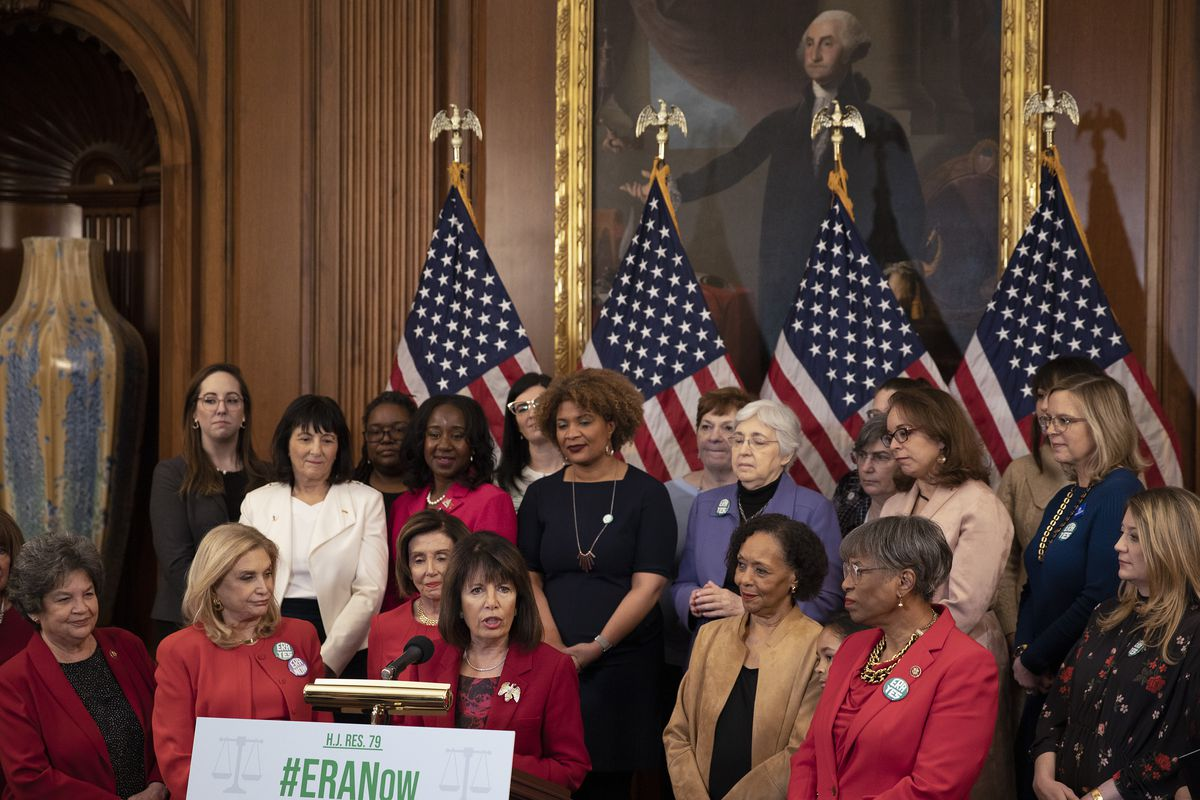 Rep. Jackie Speier speaks at a podium, flanked by women members of Congress.