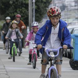 Henry Ades, 6, rides his bicycle in front of his family as they bike to Sunset Elementary School in San Francisco, Thursday, Oct. 11, 2012. When California's gas prices hit record highs over the past week, the millions of dollars spent in recent years on commuter bike lanes and public transportation projects in Los Angeles, San Francisco and other major cities were seen in a new light by many drivers. San Francisco has seen a 71-percent increase in cyclists in the past five years after city leaders spent millions in public money on new lanes stretching from the Bay to the Pacific Ocean.