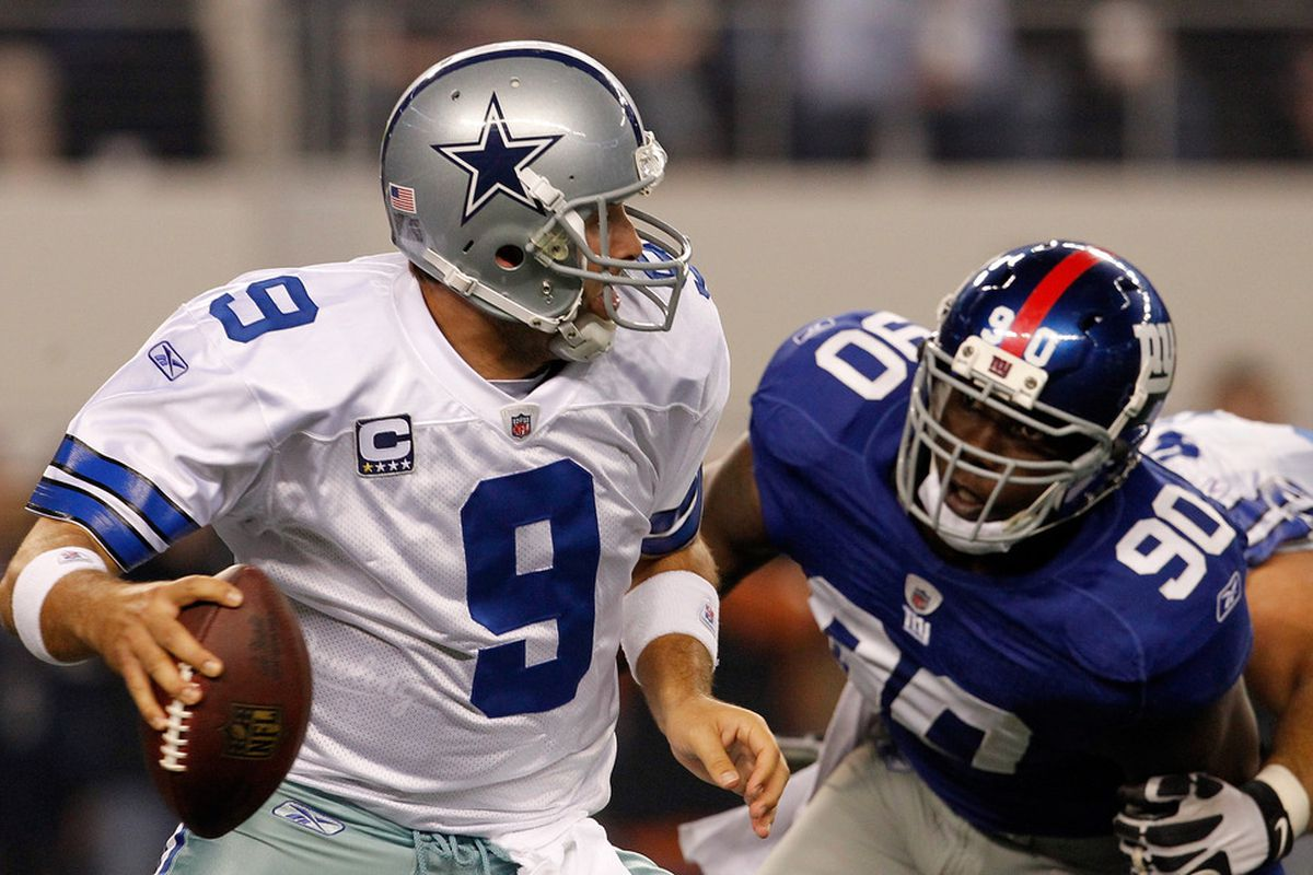 Tony Romo of the Dallas Cowboys is sacked in the New York Giants end zone by  Jason Pierre-Paul of the New York Giants for a safety at Cowboys Stadium on December 11, 2011 in Arlington, Texas.  (Photo by Tom Pennington/Getty Images)