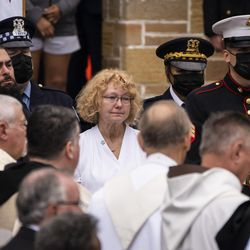 Elizabeth French, mother of Chicago Police Officer Ella French, watches as her daughter's casket is loaded into the hearse after Officer French's funeral at St. Rita of Cascia Shrine Chapel, Thursday, Aug. 19, 2021. French was fatally shot and her partner was critically wounded while in the line of duty on Aug. 7 in West Englewood.