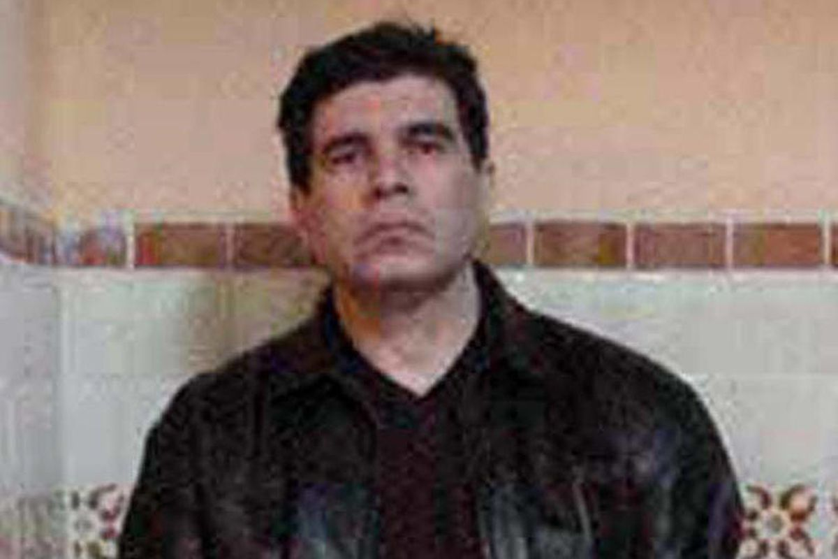 FILE - This March 9, 2002 file photo provided by the office of the Attorney General shows drug trafficker Benjamin Arellano Felix on the day of his arrest at his house in Puebla, Mexico.  Arellano Felix, one of the world's most powerful drug traffickers d