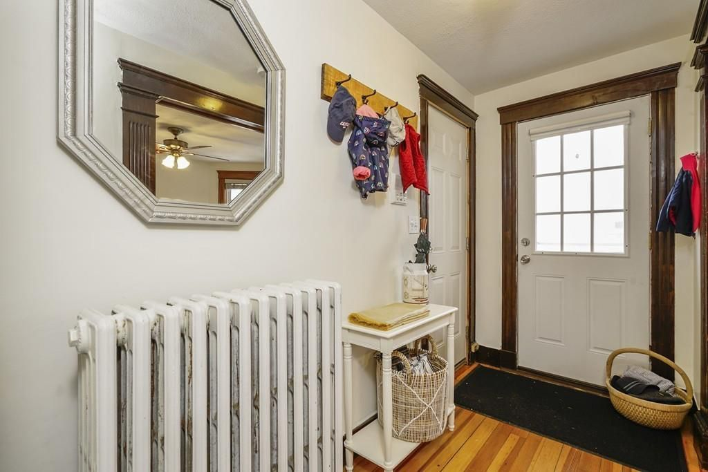 That entry hallway, with a large radiator and a front door.