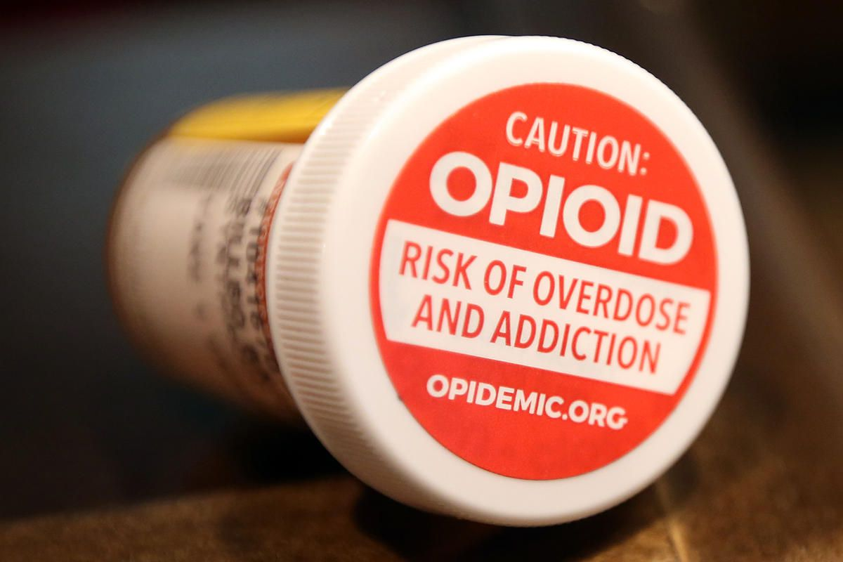 The Utah Department of Health and Utah Pharmacy Association are promoting stickers to encourage Utahns to talk to their pharmacists about the dangers of prescription opioids and the use of naloxone at Harmons City Creek in Salt Lake City on Thursday, Apri