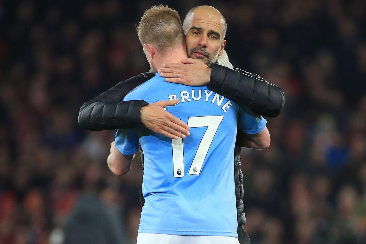 Pep Guardiola embraces Kevin De Bruyne - Manchester City - Premier League