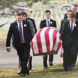 Pallbearers carry the casket of former Utah Gov. Olene Walker at the Salt Lake City Cemetery in Salt Lake City on Friday, Dec. 4, 2015. Walker died of natural causes at age 85.