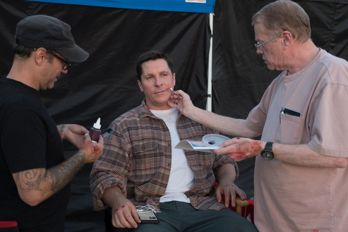 Prosthetic makeup department head Chris Gallagher, actor Christian Bale, and makeup designer Greg Cannom on the set of the movie Vice.