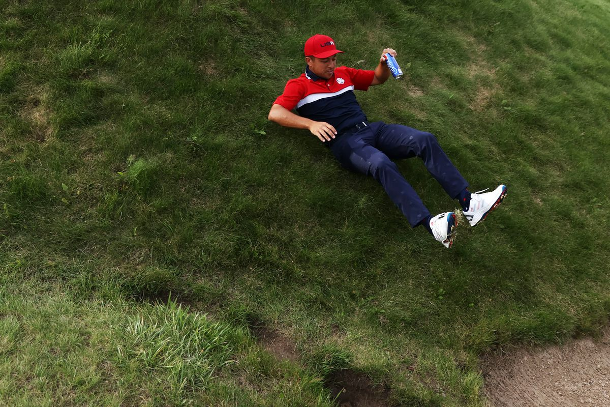 Xander Schauffele of Team United States slides down a hill on his way to the trophy ceremony following the Sunday Singles Matches of the 43rd Ryder Cup at Whistling Straits on September 26, 2021 in Kohler, Wisconsin.
