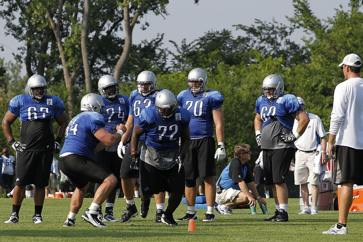 ALLEN PARK, MI - AUGUST 01: Johnny Culbreath #72 and Dan Gerberry #64 of the Detroit Lions go through their daily practice session at the Lions training facility on August 1, 2011 in Allen Park, Michigan.  (Photo by Leon Halip/Getty Images)