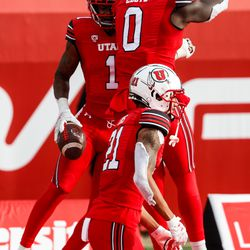 Utah Utes players celebrate as Utah Utes wide receiver Bryan Thompson (1) scores a touchdown during an NCAA football game at Rice-Eccles Stadium in Salt Lake City on Saturday, Dec. 19, 2020.