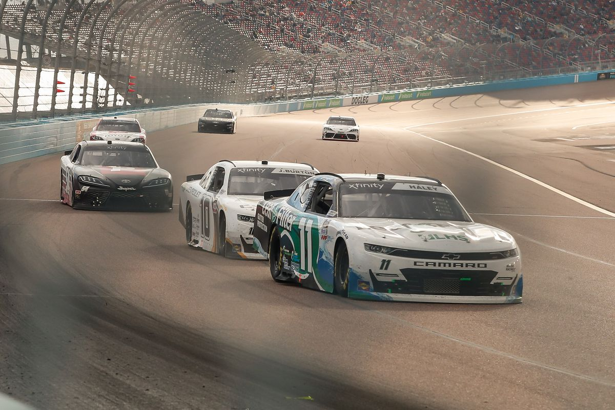 Justin Haley, driver of the #11 Kaulig Racing LeafFilter Gutter Protection Chevrolet Camaro, leads Jeb Burton, driver of the #10 Kaulig Racing Alsco Uniforms Chevrolet Chevrolet Camaro, during the Call 811 Before You Dig 200 Nascar Xfinity Series Race on March 13, 2021 at Phoenix ISM Raceway in Phoenix, Arizona.