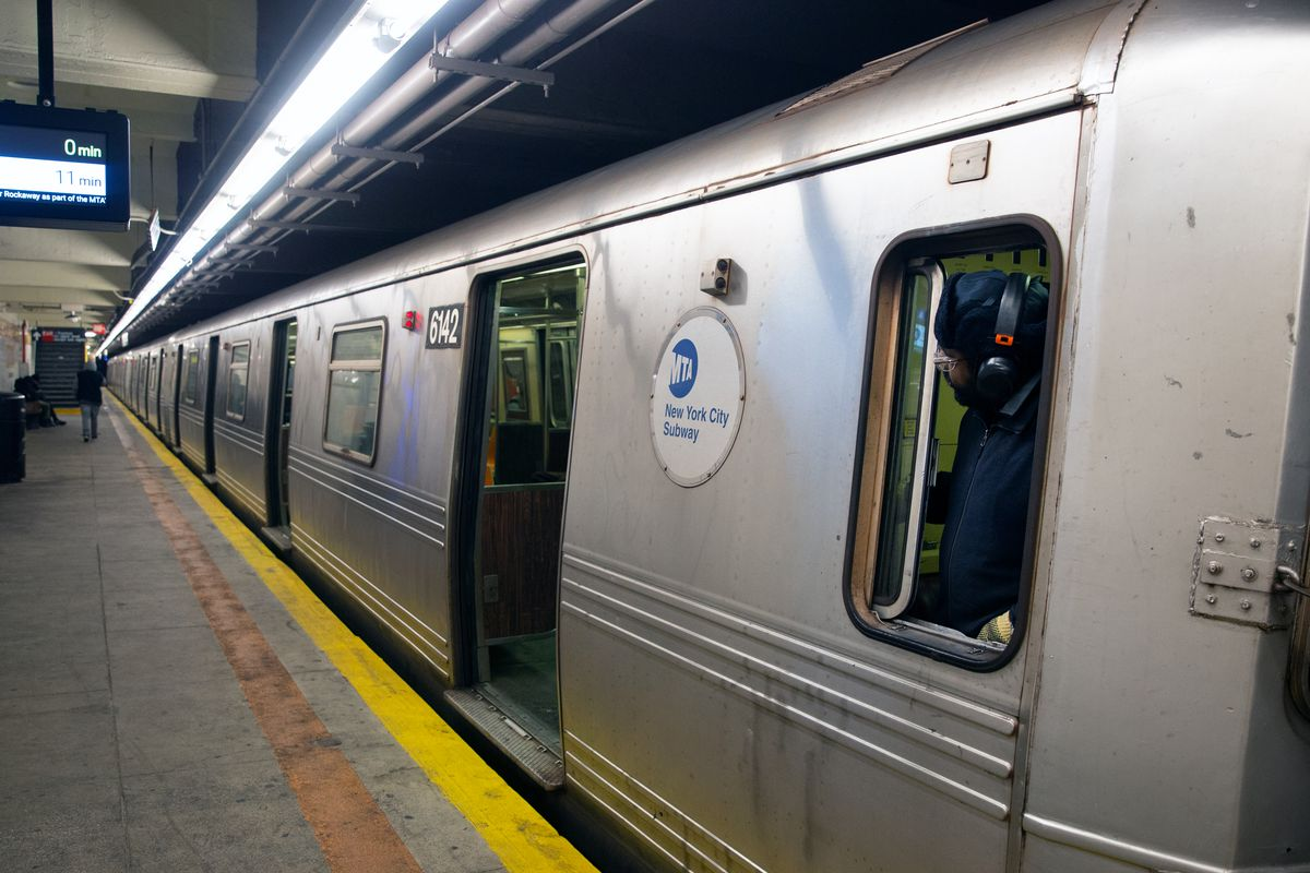 A subway conductor watches the doors of an A train in Brooklyn, April 7, 2020.
