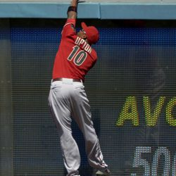 Arizona Diamondbacks right fielder Justin Upton can't reach a ball hit for a solo home run by Los Angeles Dodgers' Matt Kemp during the second inning of their baseball game, Sunday, Sept. 2, 2012, in Los Angeles.