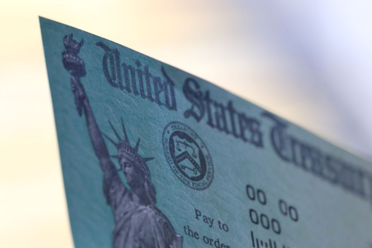 """the top left corner of an IRS refund check showing the words """"United States Treasury"""" and a picture of the Statue of Liberty."""