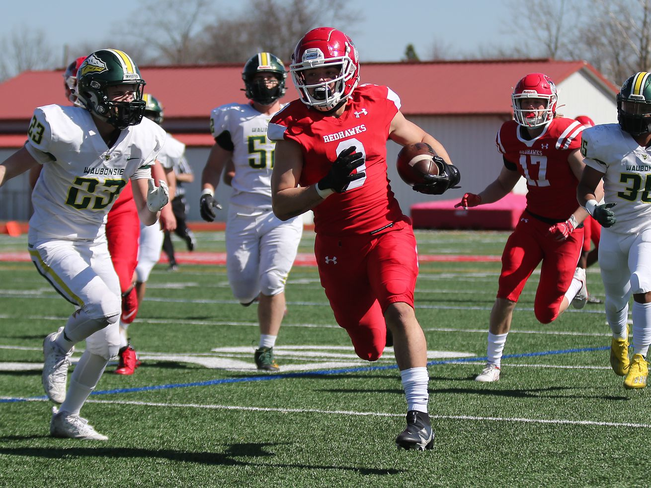 Naperville Central's Antonio Torres (3) breaks free for a touchdown against Waubonsie Valley.